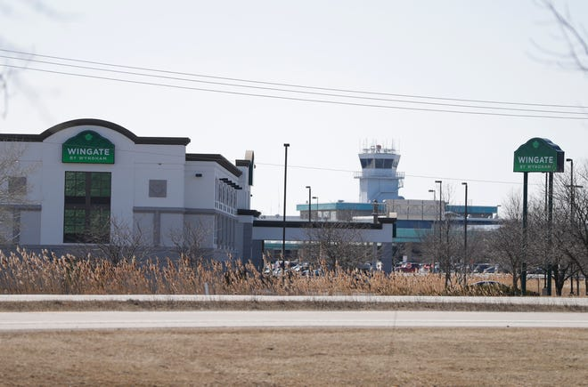The Wingate by Wyndham hotel in Ashwaubenon, with the control tower of Green Bay Austin Straubel International Airport in the backround.