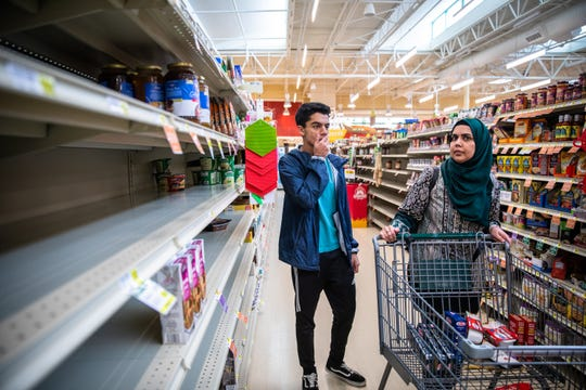 Wajih Qazi shops for groceries with his mom, Fareeha Munawar at Lowes Foods in Greer, to be donated to Greer Relief & Resources Agency in response to the coronavirus outbreak Tuesday, March 17, 2020.