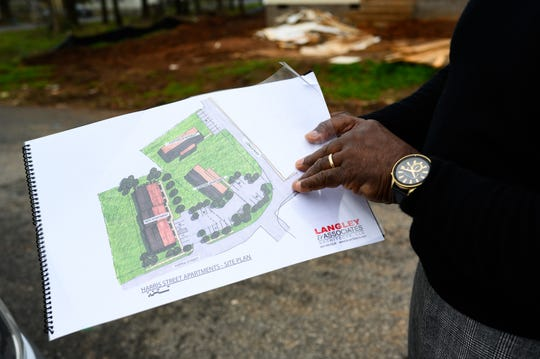 Pastor Steve Watson of New Jerusalem Baptist Church shows off plans for a new affordable apartment complex the church is planning to build next to one they already own in Greer Tuesday, March 17, 2020.