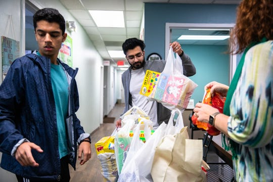 Wajih Qazi and Sameer Ebrahim deliver donated groceries to Greer Relief & Resources Agency in response to the coronavirus outbreak Tuesday, March 17, 2020.