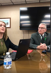 Sarah Garcia, administrator Montana Motor Vehicle Division, talks with reporters Tuesday as Attorney General Tim Fox listens.