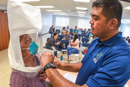 Guam Department of Education school nurse Claire Babauta, left, assigned to Lyndon B. Johnson Elementary School, is administered a N95 Fit Test by University of Guam Program Manager John Taitano at the GDOE headquarters in Tiyan, Barrigada on Tuesday, March 17, 2020. Nurses from GDOE public schools were instructed and tested for proper fit of the N95 face masks in hopes to minimize their chances of contracting the COVID-19, or the new coronavirus, when performing their duties as nurses.
