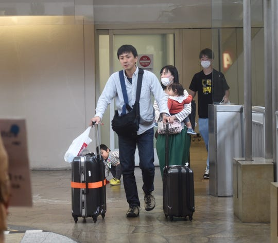 Passengers arrive at the A.B. Won Pat International Airport in Tamuning, March 17, 2020.