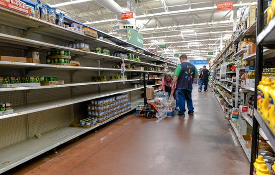 Stores struggle to keep up with demand as shoppers empty shelves at the Henderson Walmart stocking up on supplies as the coronavirus pandemic spreads across the nation forcing restaurants and bars to close Tuesday, March 17, 2020.
