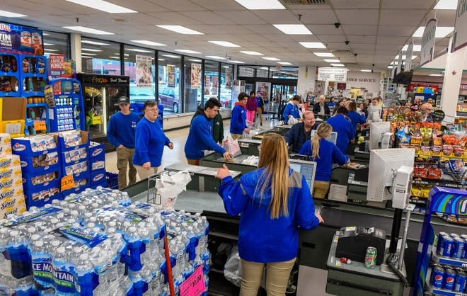 All hands were  on deck at Sureway Eastgate Monday as shoppers crowd the market stocking up on supplies after restaurants were ordered closed to inside service due to the COVID-19 pandemic.