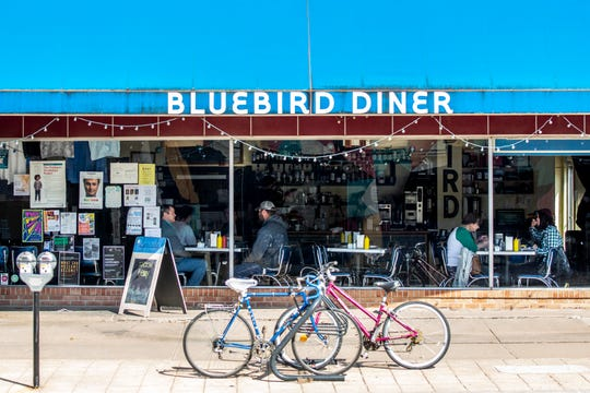 Customers eat food at Bluebird Diner prior to the noon closures for all eat-in restaurants in the state due to community spread of coronavirus, Tuesday, March 17, 2020, in Iowa City, Iowa.