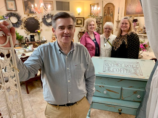 Ed Hutchison, left, along with Suzanne Hale, Charlleis Lovett and Amy Hutchison offer a glimpse of the tearoom at Merri Pennie's Mercantile & Tea Room in Canton.