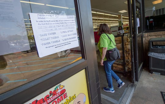 Before patrons of Mac's Fresh Market in Ridgeland enter the store Tuesday, March 17, 2020, they're alerted to the purchasing limit on some items in high demand during the coronavirus outbreak.
