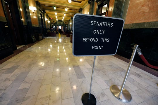 A social distance barrier prohibits passage of the public to the Senate chambers was moved further back at the Capitol in Jackson, Miss., Tuesday, March 17, 2020. The Legislature met and are working on legislation that would temporarily suspend their business and grant administrative pay to some local governmental entities.