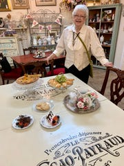 Charlleis Lovett shows some of the items that will be on the menu when the tearoom at Merrri Pennie's Mercantile & Tea Room opens in Canton.
