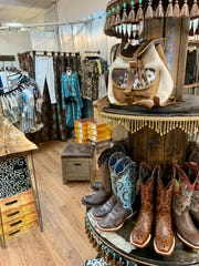 Cowboy boots are among items for sale at Merri Pennie's Mercantile & Tea Room in Canton.