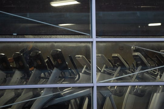 A person is seen on an elliptical at the Lindsay Young YMCA in downtown Knoxville, Tuesday, March 17, 2020. The YMCA of East Tennessee will not be offering group programing through March 22, and will close at 8pm through Friday.