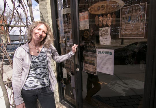 Lisa Jarrell, who co-owns Finding Roots in downtown Howell, lives with uncertainty, having closed the store temporarily due to the coronavirus. She stands next to the closed business Tuesday, March 17, 2020.