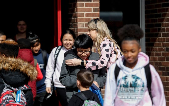 Klondike school teacher Jordan Royse says goodbye to students on March 13, 2020, as they leave for an extended break because of the coronavirus threat.