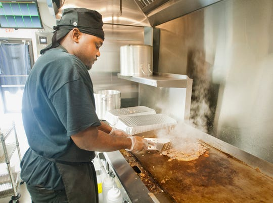 Barry's Cheesesteaks cook Demetric Watson prepares a mushroom sandwich at the restaurant on Bardstown Road at Taylorsville Road. March 13, 2020