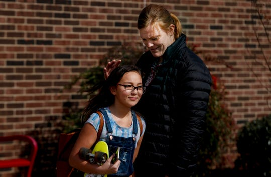 On the last day of school, March 13, 2020, because of the coronavirus pandemic, Klondike Elementary teacher Lisa Petry says goodbye to Vivian Ising as the students head home.