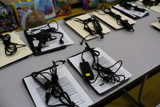 Chrome books are lined up waiting to be picked up by parents for use by their children, Tuesday, March 17, 2020, in Manitowoc, Wis. Manitowoc Public Schools will be conducting classes online during the COVID-19 crisis.