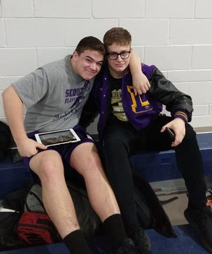 Lexington senior Hayden Hoskins, right, with teammate and drill partner Ammon Parr at the Division II district wrestling tournament in Norwalk.