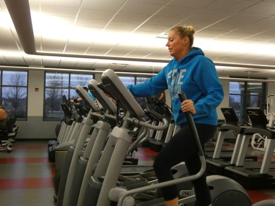 Jenni Myers gets in one last workout Monday before the Marion Family YMCA closed that night, following an announcement by Ohio Gov. Mike DeWine that all gyms, fitness centers, bowling alleys and other recreational places would be closed to protect public health amid the coronavirus pandemic.