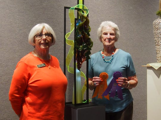 Connie Lowery, flower show chairman, with Kathleen Hawryluk, winner of the first place illuminary design.