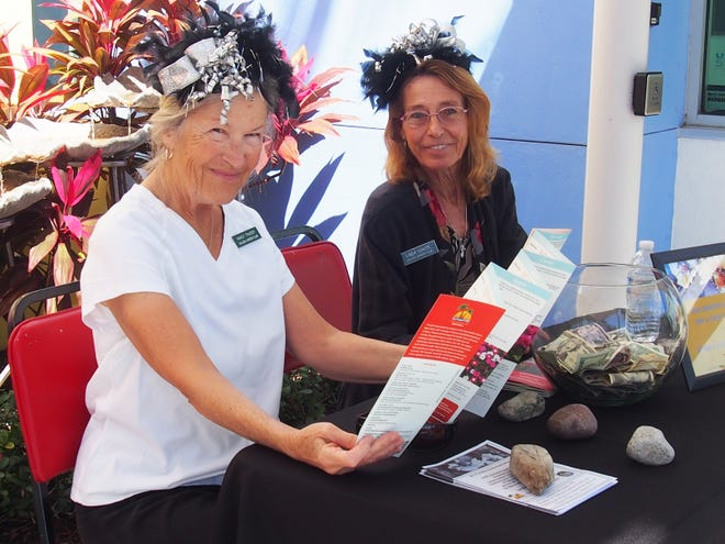 Nancy Traiser and Linda Chute welcome visitors to the flower show.