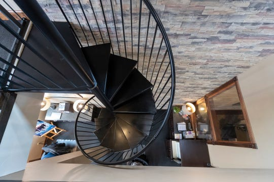 A staircase leads from the first floor office area to the office on the second floor at the residence of Leticia Guzman and Curt Otto.