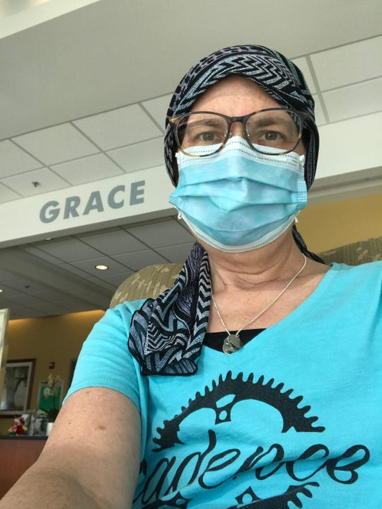 Lori Ahrenhoerster wears a mask to her medical appointments and chemotherapy sessions at Froedtert Hospital.