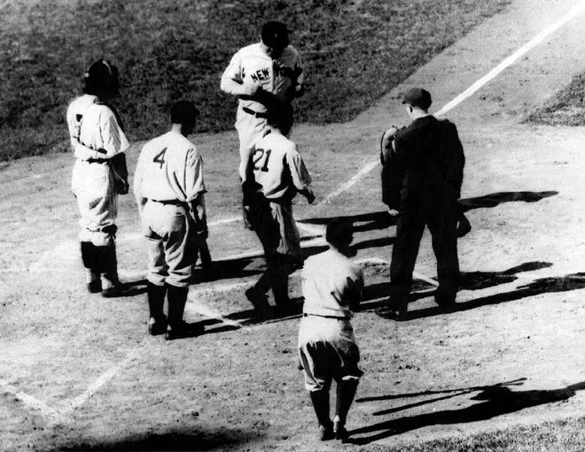Babe Ruth crosses home plate after a home run in the third game of the 1932 World Series against the Chicago Cubs at Wrigley Field.