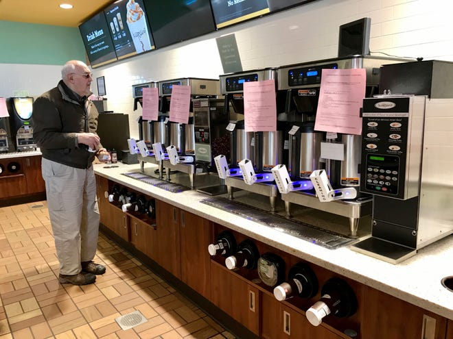 A customer stands in front of a coffee station that has been shut down to stop the spread of the coronavirus at Kwik Trip in Richfield on Tuesday, March 17, 2020. While St. Patrick's Day was shut down by the coronavirus as Milwaukee and 10other Milwaukee County municipalities ordered bars and restaurants to close, bars and restaurants scattered outside Milwaukee County celebrated St. Patrick's Day under the Disease Control and Prevention (DCD) recommendations that gatherings be limited to 50 people or less for the next eight weeks.   Photo by MIKE DE SISTI / MILWAUKEE JOURNAL SENTINEL