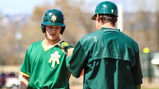 Mountain Home's Matt Robbins after getting on base for Arkansas Tech last season.