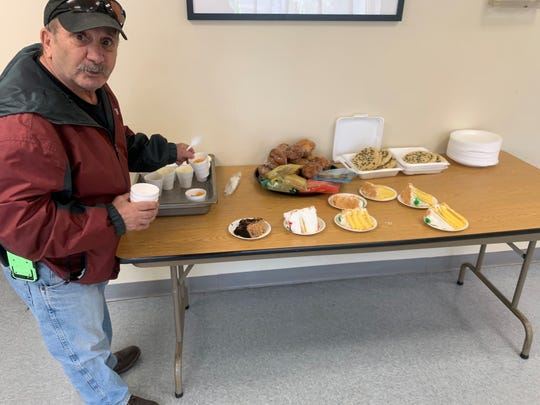 Morristown Housing Authority residents enjoy cake, jello and baked goods provided by the Morristown Housing Authority.