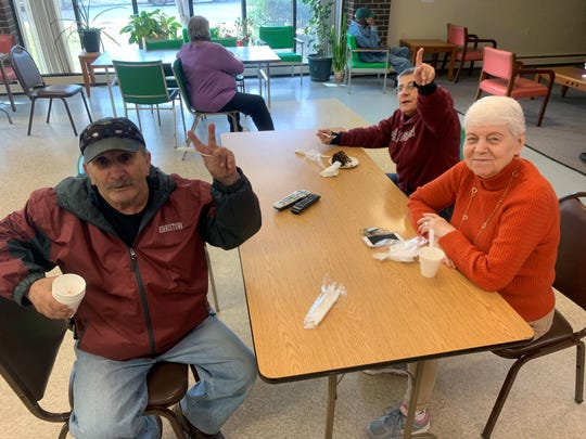 Seniors at Morristown Housing Authority enjoy cake and snacks donated by the Morristown Diner.