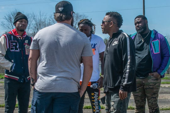 Music producer Noah Baker, second from right, speaks with artists before filming begins for his new project Alabama Massacre 11.