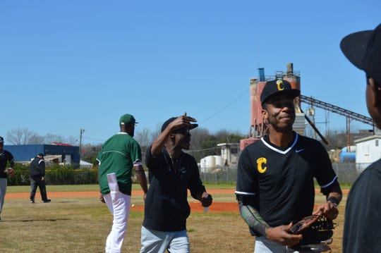 Carver baseball coach Eric Nelson yells commands at his team between innings.