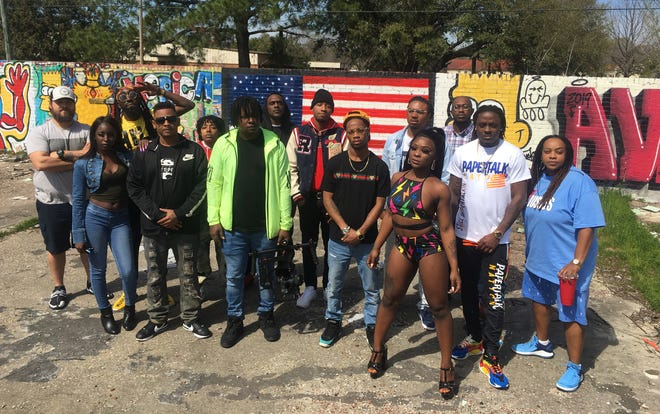 Music producer Noah Baker, fourth from left, with area music artists during filming for his upcoming project Alabama Massacre 11 in Montgomery.