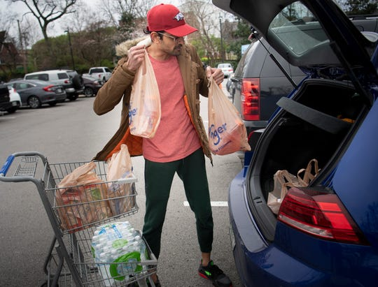 Pratik Doshi volunteered to pick up groceries and deliver them to immunocompromised neighbors as they isolate during the coronavirus outbreak Tuesday, March 17, 2020 in Nashville, Tenn.