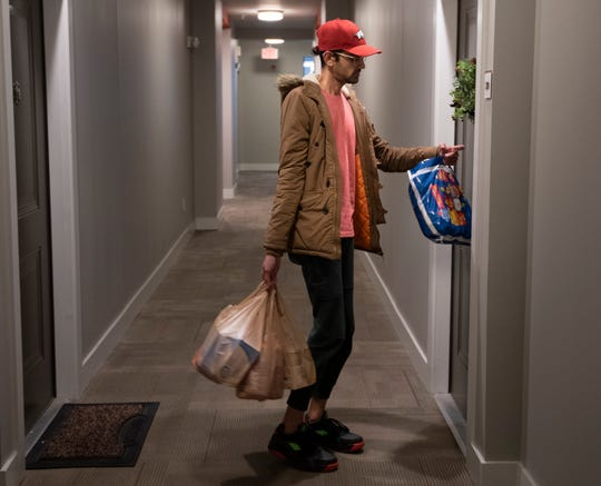 Pratik Doshi volunteered to pick up groceries and deliver them to immune compromised neighbors as they isolate during the coronavirus outbreak  Tuesday, March 17, 2020 in Nashville, Tenn.