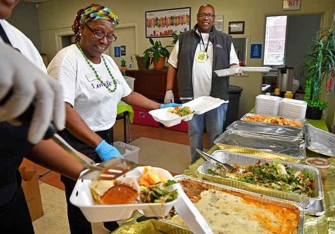 Hiedy Jackson and Bordeaux Center Director Melvin Fowler fix hot meals provided by the Nashville Food Project that were distributed to FiftyForward Bordeaux members from 11 a.m. to noon on Tuesday. The center also passed out food bags and fresh flowers to seniors.