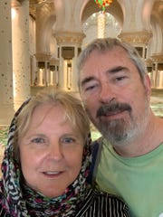 Martin and Constance Breland sent a photograph to their family from a stop on their trip. Now they have been stranded on a cruise ship for 13 days.