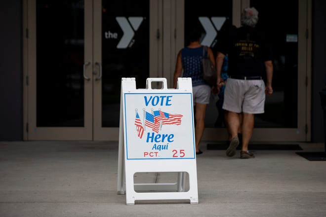 A sign directs voters to the polling location at the Bonita Springs YMCA on Tuesday, March 17, 2020.