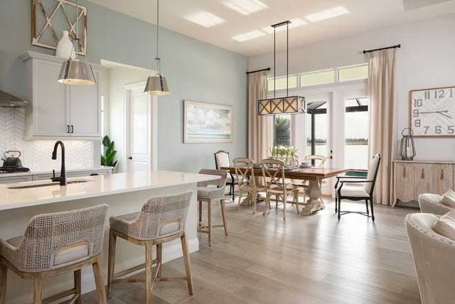 Generous clearance space around eating and serving areas are two of the Universal Design features Divco Custom Homes incorporates in its Cypress model.
