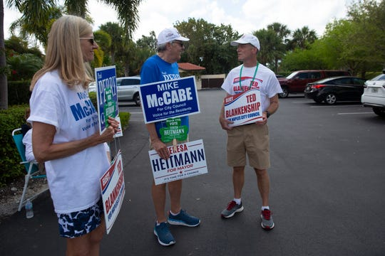 Ted Blankenship, right, talks with community members as he campaigns for himself outside of St. John Episcopal Church, Tuesday, March 17, 2020, in Naples.