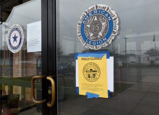 """Sign informing voters that the planned March 17 election has been canceled at the American Legion in Newark. Governor Mike DeWine declared a """"health emergency"""" and closed the state's polling places because of a health crisis that has shut down much of American society. The new deadline for the election is April 28."""
