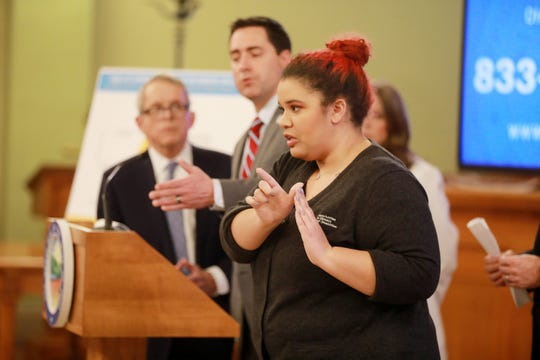 Lena Smith relays the words of Ohio Secretary of State at a coronavirus news conference Monday, March 16, 2020 at the Ohio Statehouse.  Smith works for Opportunties for Ohioians With Disabilities, a state agency. (Doral Chenoweth/Dispatch)