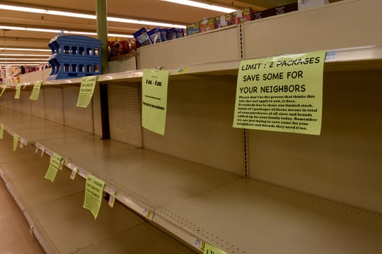 Signs telling patrons that the will be limited to two packages of paper towels because of the coronavirus health crisis at Ross' Granville Market. The store has placed limits on many items. As of Tuesday limited items included paper towels, toilet paper, water, toilet bowl cleaner, bleach, sanitizing wipes, sanitizer, Lysol, flour, sugar, eggs, and milk.