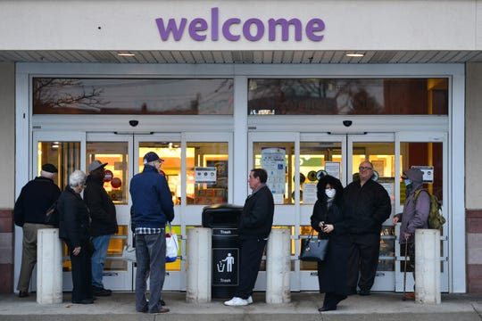 Shoppers arrive at Stop & Shop before the store opens in Hackensack at Summit Plaza on Tuesday March 17, 2020. Beginning Thursday, March 19th, all Stop & Shop stores will open earlier in order to service only customers who are age 60 and over from 6:00a.m.-7:30a.m. daily.