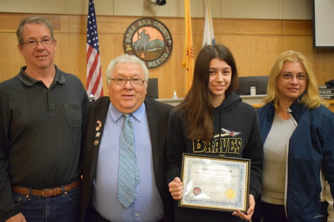 Pictured with her parents, Overcomer Award winner, from left: Paul Duval, Anna's father, Doña Ana County Dist. 2 Commissioner Ramon S. Gonzalez, Anna Hariklia Duval, Overcomer Award winner, and her mother, Vicky Kyrimis.