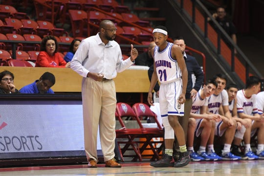 Las Cruces High head basketball coach William Benjamin, coached the Bulldawgs to the Class 5A state title with his son, Deuce Benjamin, starting at the point guard position as a sophomore.