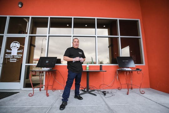 Gonzalo Chavez said Taqueria Chavez is implementing technological advances to help serve customers. He's showing new kiosks outside of the restaurant Tuesday, March 17, 2020.
