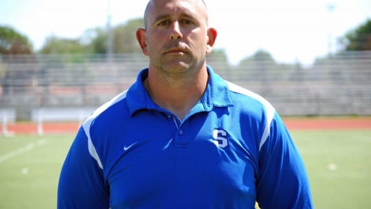 Patrick Ignagni has been hired as the new Salem football coach.
